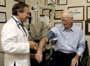 Dr. Levy examining an older man