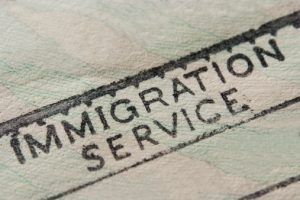 Immigration Service stamped on paper